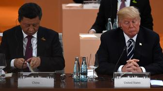 China's President Xi Jinping (L) and US President Donald Trump attend a working session on the first day of the G20 summit in Hamburg, northern Germany, on July 7, 2017.  Leaders of the world's top economies gather from July 7 to 8, 2017 in Germany for likely the stormiest G20 summit in years, with disagreements ranging from wars to climate change and global trade. / AFP PHOTO / Patrik STOLLARZ        (Photo credit should read PATRIK STOLLARZ/AFP/Getty Images)