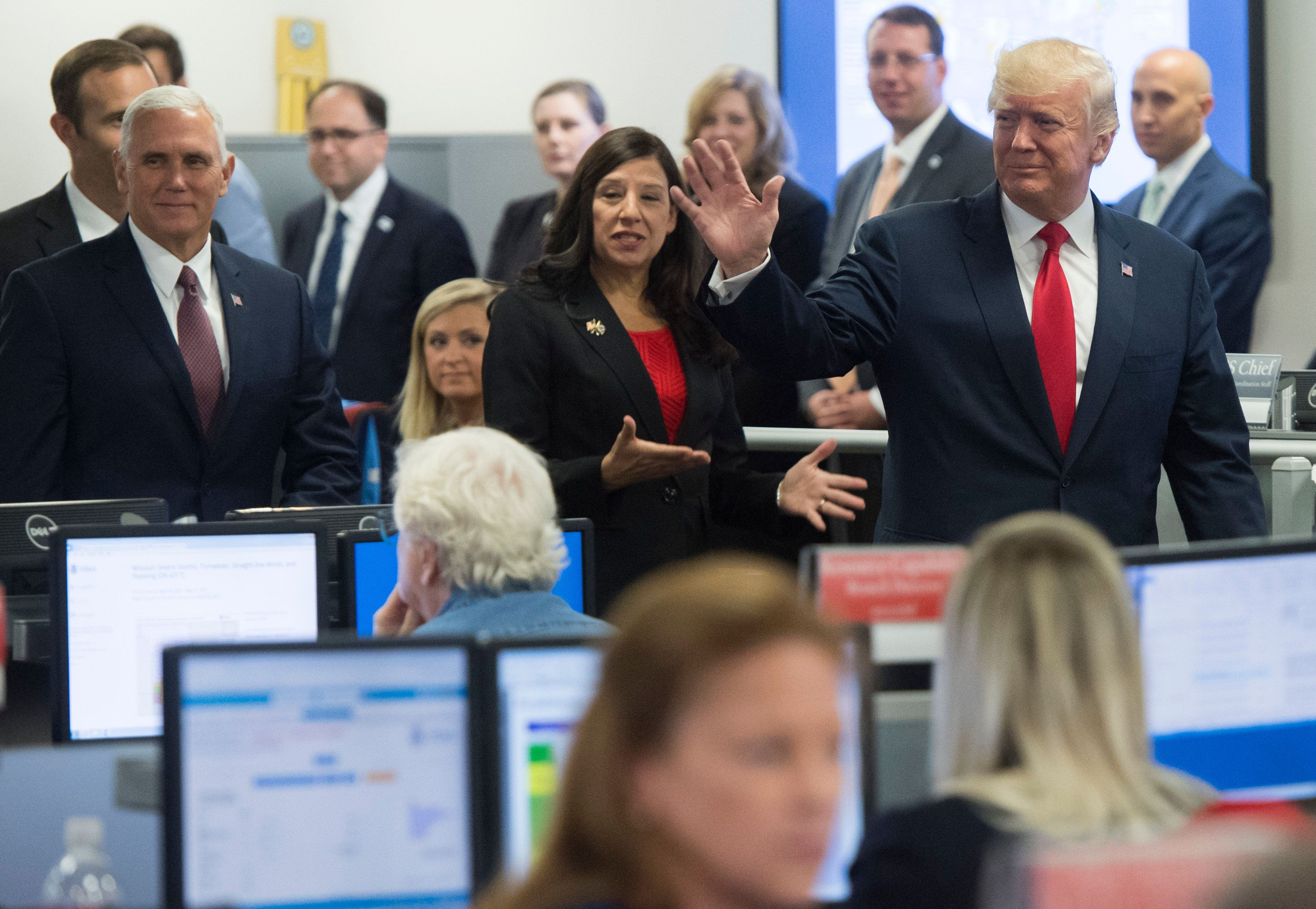 US President Donald Trump along with US Vice President Mike Pence(L) walks through the FEMA Command Center following a briefing on hurricane season at FEMA Headquarters in Washington, DC, August 4, 2017. / AFP PHOTO / SAUL LOEB        (Photo credit should read SAUL LOEB/AFP/Getty Images)