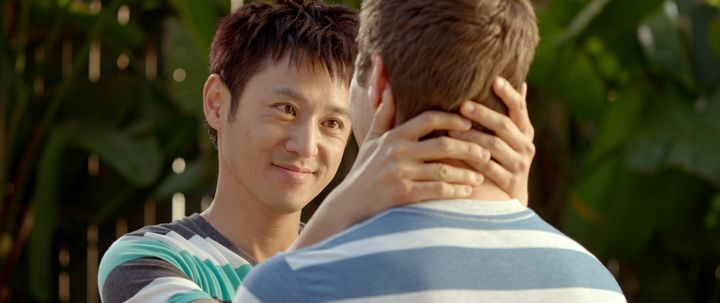 Danny (Barney Cheng) neck-hugs his lover.