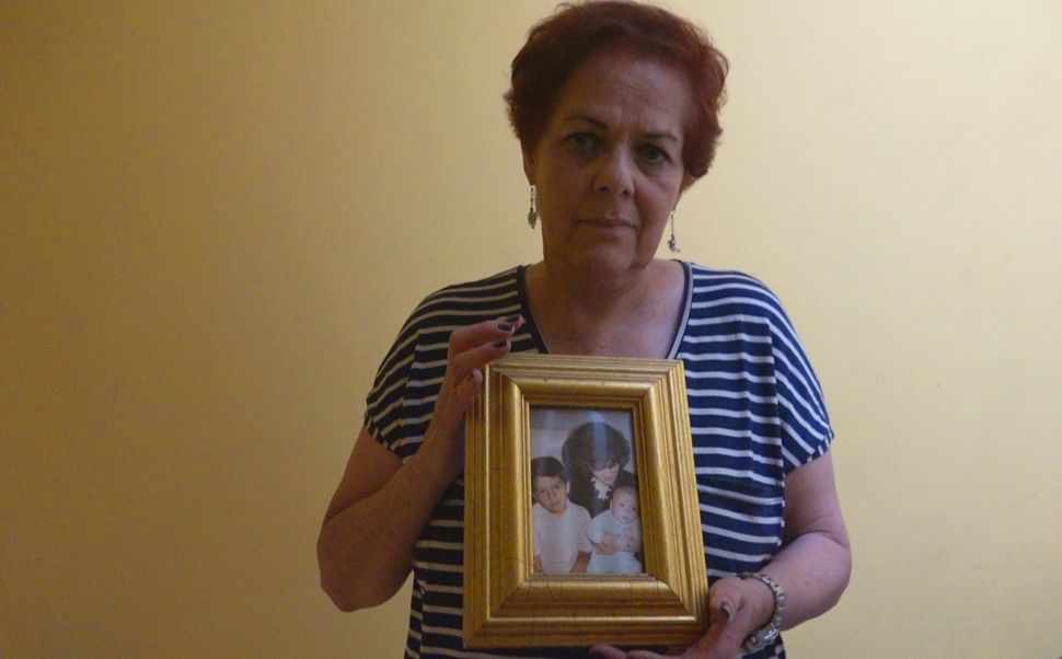 Blanca Aviña Guerrero holds a photo of her son, who she says was arbitrarily detained by the police in Mexico City.