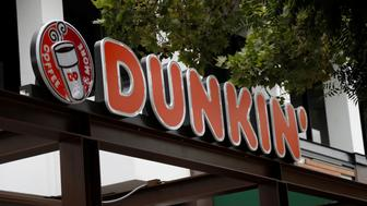 The sign of a Dunkin' store, the first since a rebranding by the Dunkin' Donuts chain, is pictured ahead of its opening in Pasadena, California, U.S., August 2, 2017. REUTERS/Mario Anzuoni