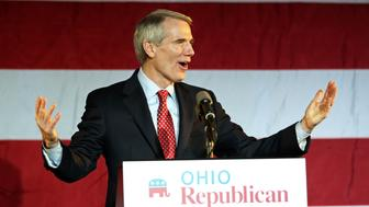 U.S. Sen. Rob Portman (R-OH) speaks to the crowd at  Ohio Republican U. S. Sen. candidate Josh Mandel's election night rally in Columbus, Ohio, November 6, 2012. REUTERS/Aaron Josefczyk (UNITED STATES  - Tags: POLITICS ELECTIONS USA PRESIDENTIAL ELECTION)