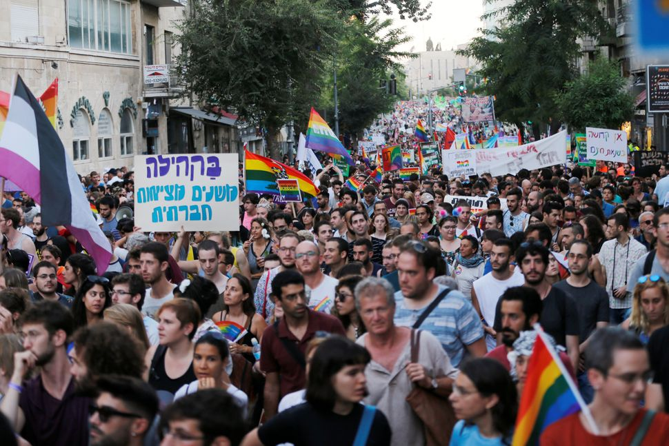 Participants march in Jerusalem's 16th Gay Pride Parade August 3, 2017.