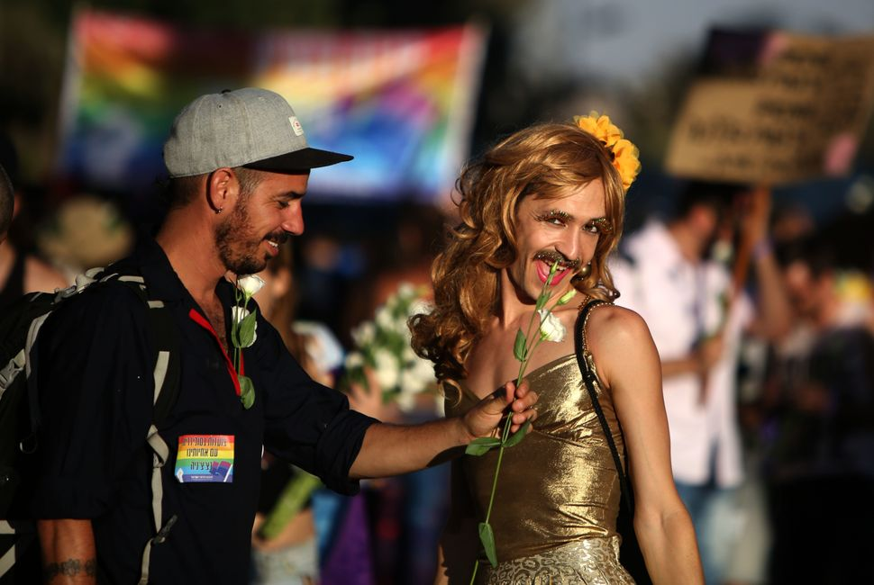 Participants attend the annual Jerusalem Gay Pride Parade on August 3, 2017.