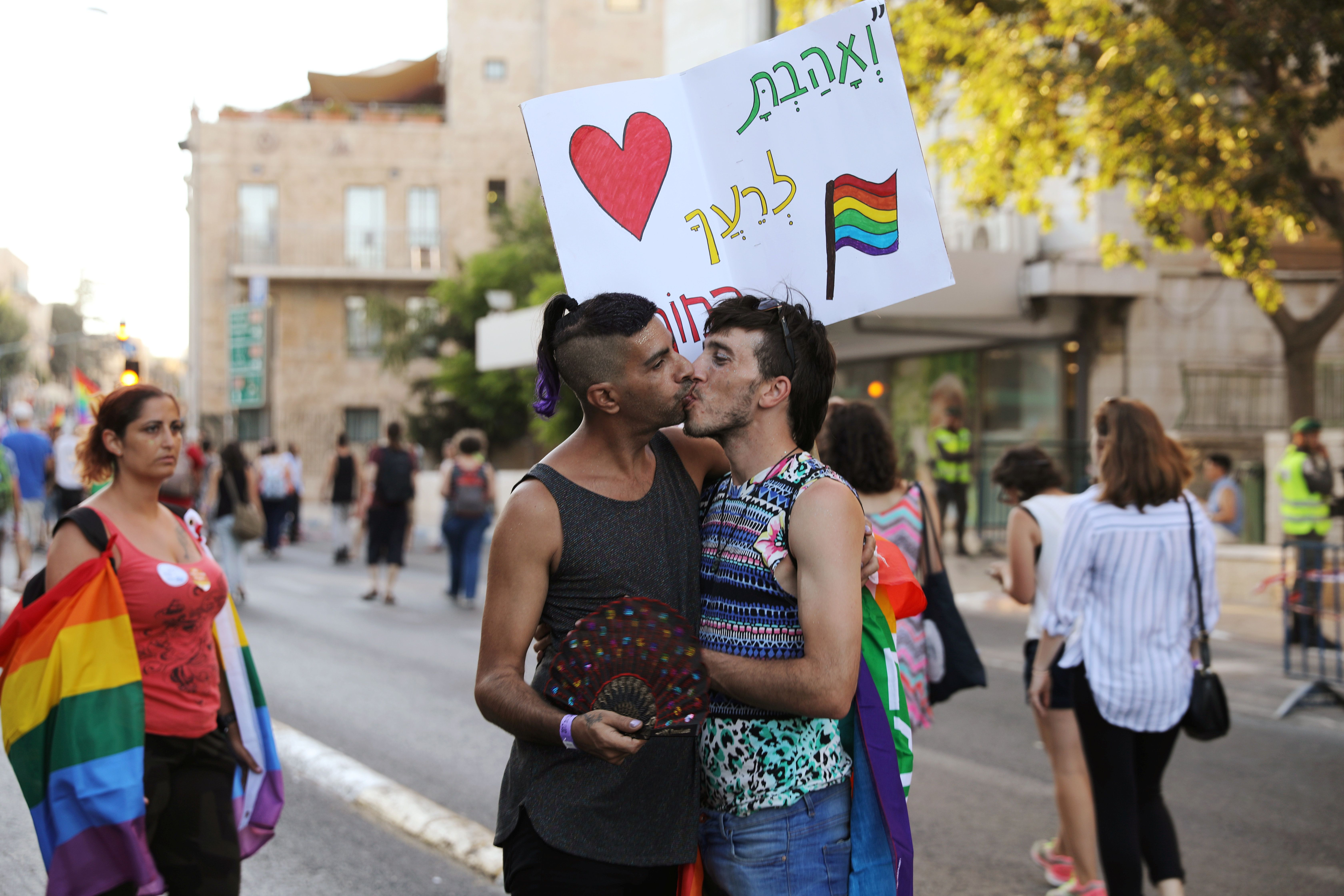 Participants kiss during a march in Jerusalem's 16th Gay Pride Parade August 3, 2017. REUTERS/ Ammar Awad