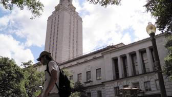 A student walks at the University of Texas campus in Austin, Texas, June 23, 2016. The U.S. Supreme Court on Thursday, upheld the practice of considering race in college admissions, rejecting a white woman's challenge to a University of Texas affirmative action program designed to boost the enrollment of minority students. REUTERS/Jon Herskovitz