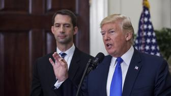 U.S. President Donald Trump, right, speaks while Senator Tom Cotton, a Republican from Arkansas, left, and listens during an introduction of the Reforming American Immigration for a Strong Economy (RAISE) Act in the Roosevelt Room of the White House in Washington, D.C., U.S., on Wednesday, Aug. 2, 2017. The legislation would reduce legal immigration to the U.S. and evaluate visa applications based on merit. Photographer: Zach Gibson/Bloomberg via Getty Images
