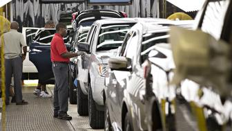 Workers perform a final inspection of vehicles at the Nissan Motor Co. North America manufacturing plant in Canton, Mississippi, U.S., on Thursday, Sept. 8, 2016. The U.S. Census Bureau is scheduled to release durable goods figures on September 28. Photographer: Daniel Acker/Bloomberg via Getty Images