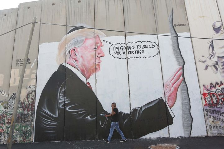 LushSux painted this mural featuring President Donald Trump on the Israeli separation barrier in the West Bank town of Bethle