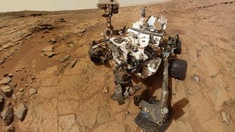 "NASA's Mars rover Curiosity is pictured in this February 3, 2013 handout self-portrait obtained by Reuters February 9, 2013. The image was made by combining dozens of exposures taken by the rover's Mars Hand Lens Imager (MAHLI). The rover is positioned at a patch of flat outcrop called ""John Klein,"" which was selected as the site for the first rock-drilling activities by Curiosity. The rover's robotic arm is not visible in the mosaic. MAHLI, which took the component images for this mosaic, is mounted on a turret at the end of the arm. The arm was positioned out of the shot in the images or portions of images used in the mosaic. REUTERS/NASA/Handout.   (UNITED STATES - Tags: SCIENCE TECHNOLOGY) FOR EDITORIAL USE ONLY. NOT FOR SALE FOR MARKETING OR ADVERTISING CAMPAIGNS. THIS PICTURE WAS PROCESSED BY REUTERS TO ENHANCE QUALITY. AN UNPROCESSED VERSION WILL BE PROVIDED SEPARATELY"