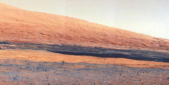 This NASA image taken by the Mast Camera (MastCam) on its Curiosity rover in 2012 highlights the geology of Mount Sharp, a mo