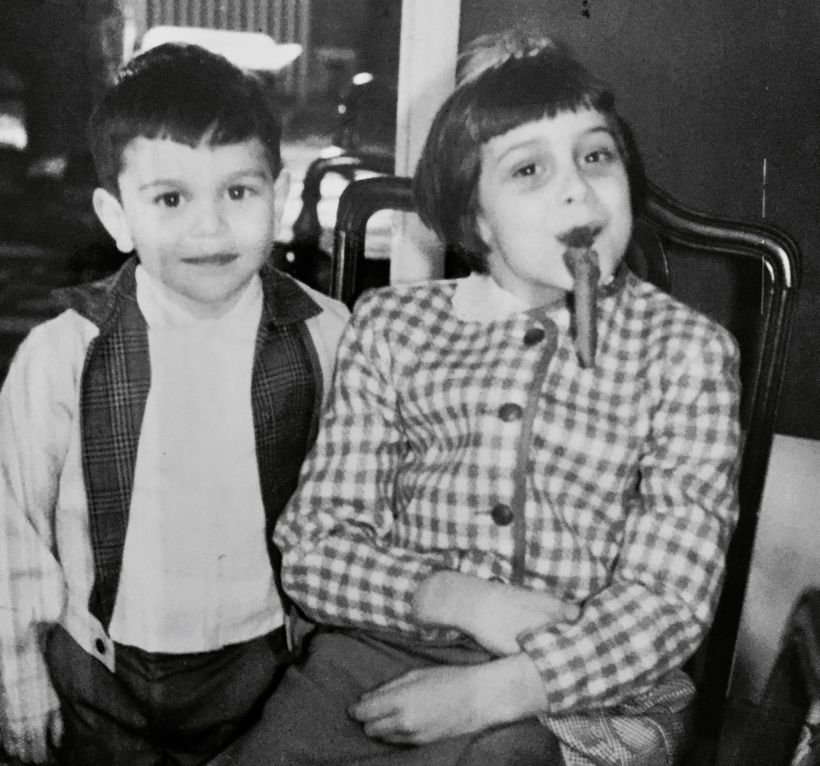 Circa 1962 with my brother Mark borrowing one of the men's cigars while I escaped as the girls were doing the dishes!