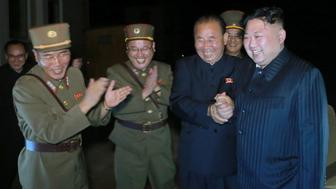 North Korean leader Kim Jong Un guides the second test-fire of intercontinental ballistic missile (ICBM) Hwasong-14 in this undated picture provided by KCNA in Pyongyang on July 29, 2017. KCNA via Reuters ATTENTION EDITORS - THIS IMAGE WAS PROVIDED BY A THIRD PARTY. REUTERS IS UNABLE TO INDEPENDENTLY VERIFY THIS IMAGE. SOUTH KOREA OUT. NO THIRD PARTY SALES. NOT FOR USE BY REUTERS THIRD PARTY DISTRIBUTORS.Ê     TPX IMAGES OF THE DAY