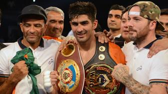 Indian boxer and WBO Asia-Pacific Super Middleweight champion Vijender Singh (C) celebrates after winning the double title bout against China's Zulpikar Maimaitiali at the National Sports Complex of India (NSCI) Dome in Mumbai on August 5, 2017. / AFP PHOTO / PUNIT PARANJPE        (Photo credit should read PUNIT PARANJPE/AFP/Getty Images)