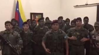 Armed men declare an uprising against the ruling government in a video posted online