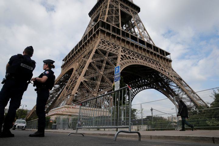 French police patrol near the Eiffel tower as part of security measures in Paris, France, July 13, 2017.
