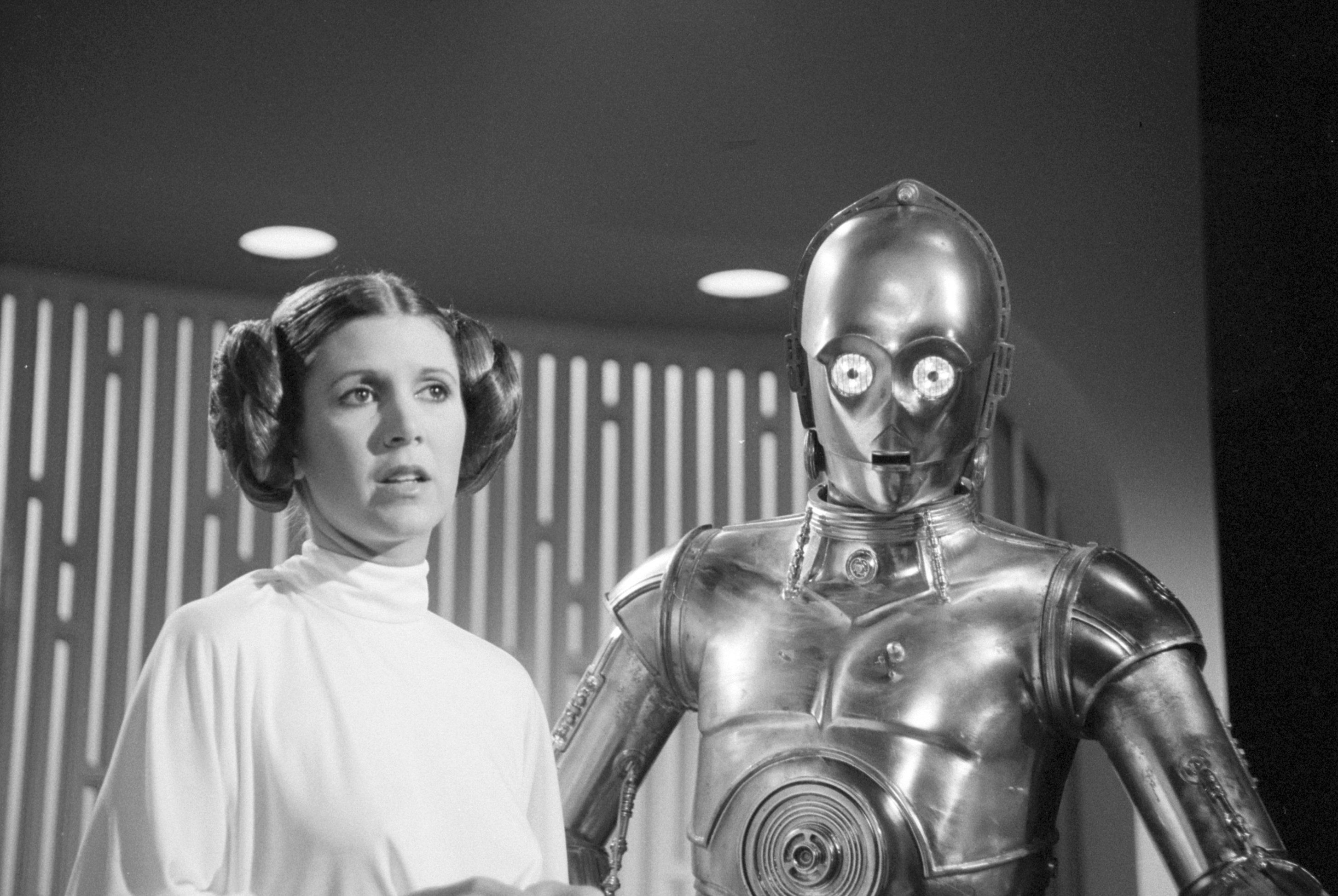 LOS ANGELES - AUGUST 23: THE STAR WARS HOLIDAY SPECIAL. Carrie Fisher (as Princes Leia) and Anthony Daniels (as C3PO) .  Image dated August 23, 1978. (Photo by CBS via Getty Images)
