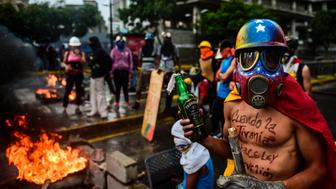 Opposition activists hold a protest against the newly inaugurated Constituent Assembly in Caracas on August 4, 2017. Venezuelan President Nicolas Maduro installed a powerful new assembly packed with his allies, dismissing an international outcry and opposition protests saying he is burying democracy in his crisis-hit country. / AFP PHOTO / RONALDO SCHEMIDT        (Photo credit should read RONALDO SCHEMIDT/AFP/Getty Images)