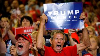 Local residents react as U.S. President Donald Trump arrives at a rally in Huntington, West Virginia, U.S., August 3, 2017. REUTERS/Carlos Barria         TPX IMAGES OF THE DAY