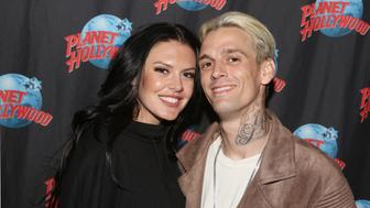 NEW YORK, NY - APRIL 24:  Photographer Madison Parker and boyfriend Aaron Carter poses during a handprint ceremony and meet and greet with fans as he visits Planet Hollywood Times Square on April 24, 2017 in New York City.  (Photo by Bruce Glikas/Bruce Glikas/FilmMagic)
