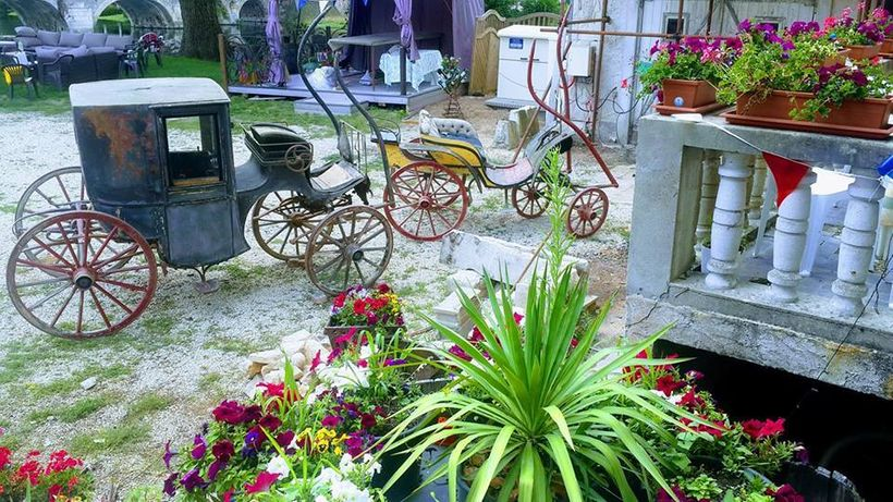 <em>The romantic courtyard being restored, complemented by two antique carriages.</em>