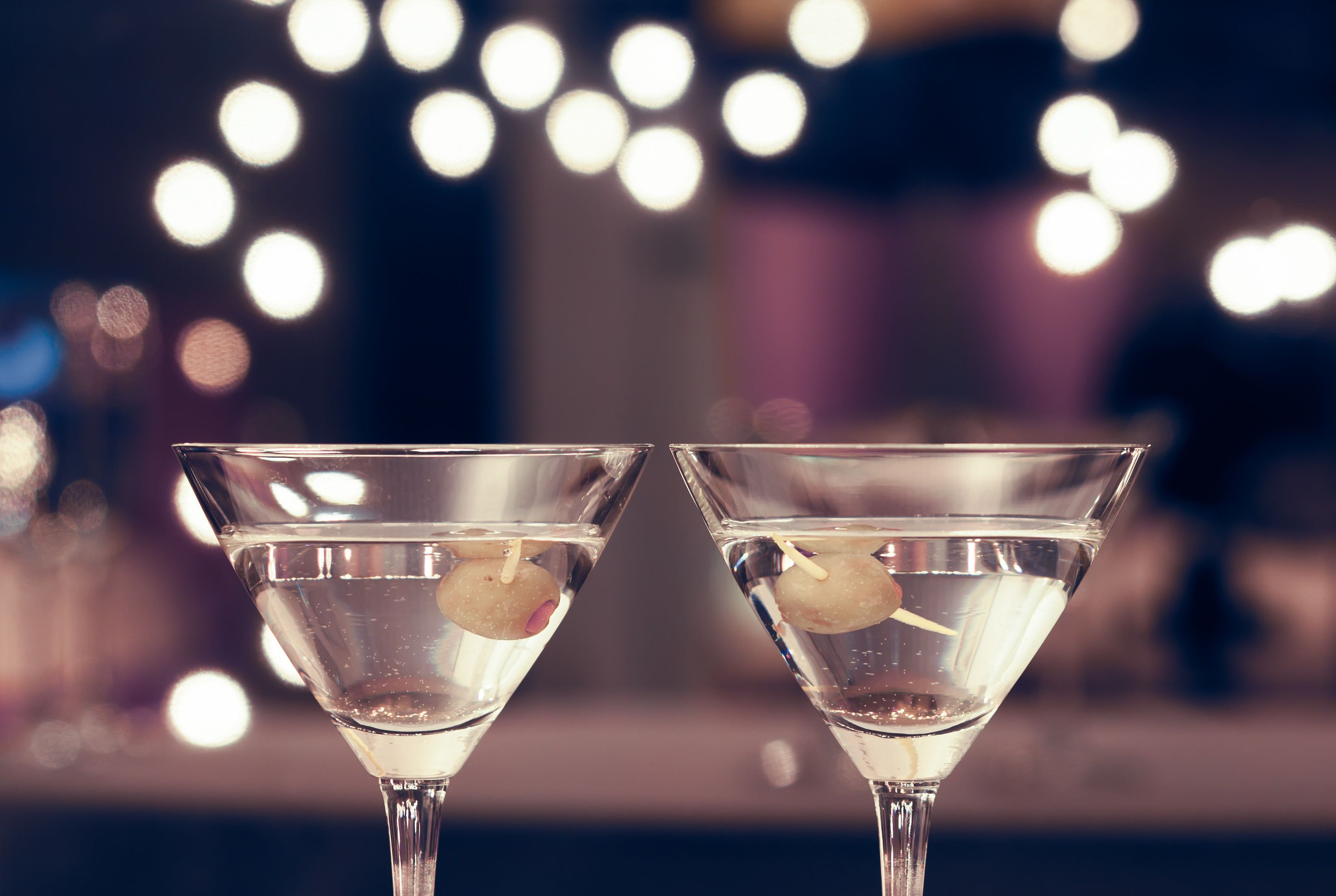 Photograph of two cocktail glasses in the fine dining restaurant setting.