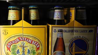 SAN FRANCISCO, CA - AUGUST 03:  Bottles of Anchor Steam beer are displayed on a shelf at Coit Liquor on August 3, 2017 in San Francisco, California. San Francisco based Anchor Brewing announced plans to sell to Japan's Sapporo Holdings Ltd for an undisclosed amount. Anchor Steam has brewed in San Francisco for 121 years.  (Photo by Justin Sullivan/Getty Images)