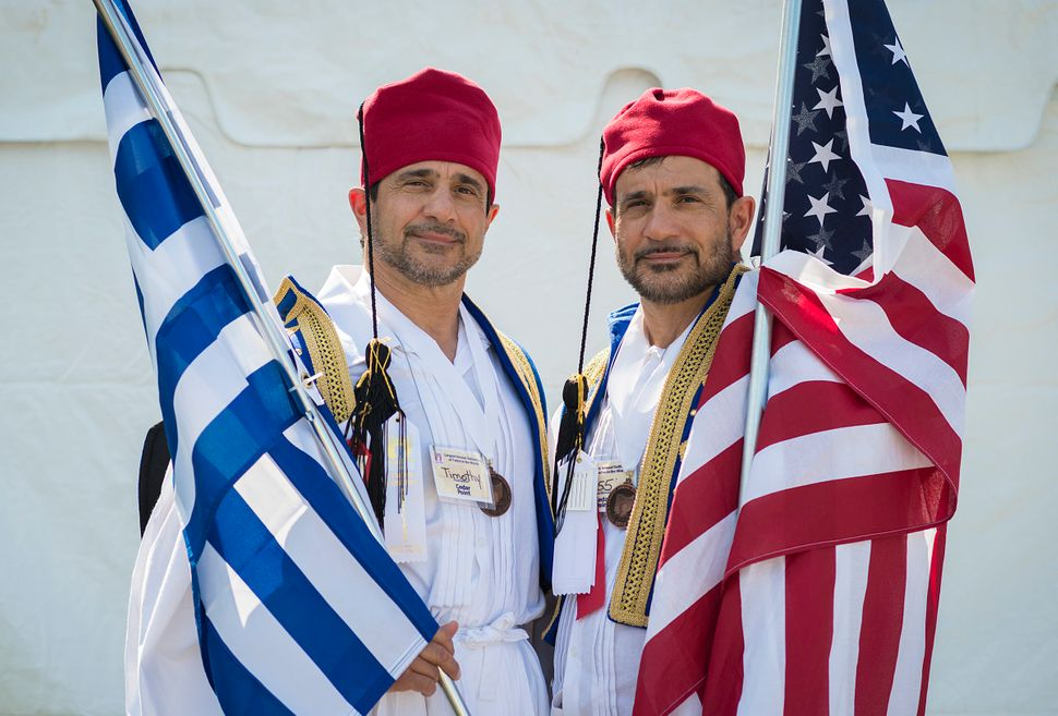 Timothy (left) and Larry Leonakis express their Greek and American pride.