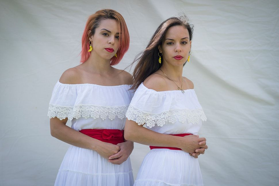 Julie (left) and Angelica Rivera highlighttheir Puerto Rican heritage.