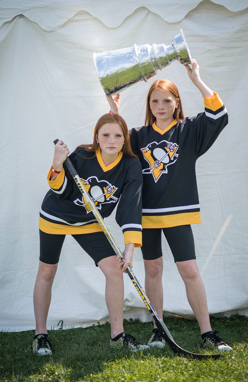 Kyleigh (left) and Ryleigh cheer the Pittsburgh Penguins' back-to-back Stanley Cup wins.