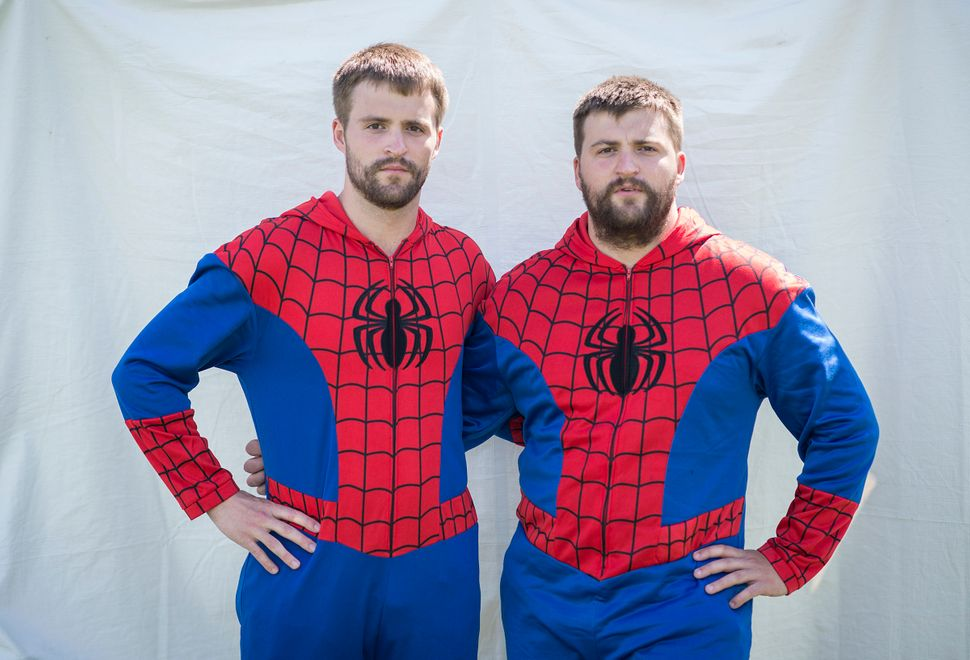 Cody(left) and Chase Strawser bow to Spider-Man. Or are theyPeter Parker?