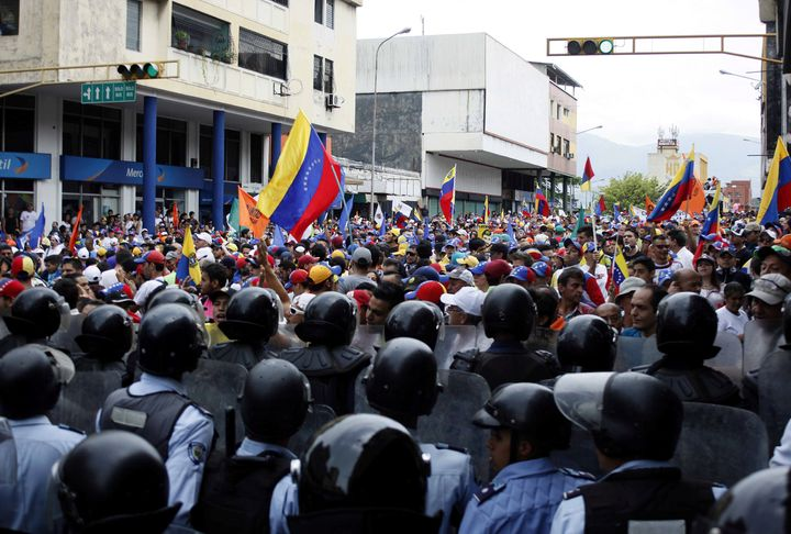 Opposition supporters clash with police during protests against unpopular leftist President Nicolas Maduro in San Cristobal,