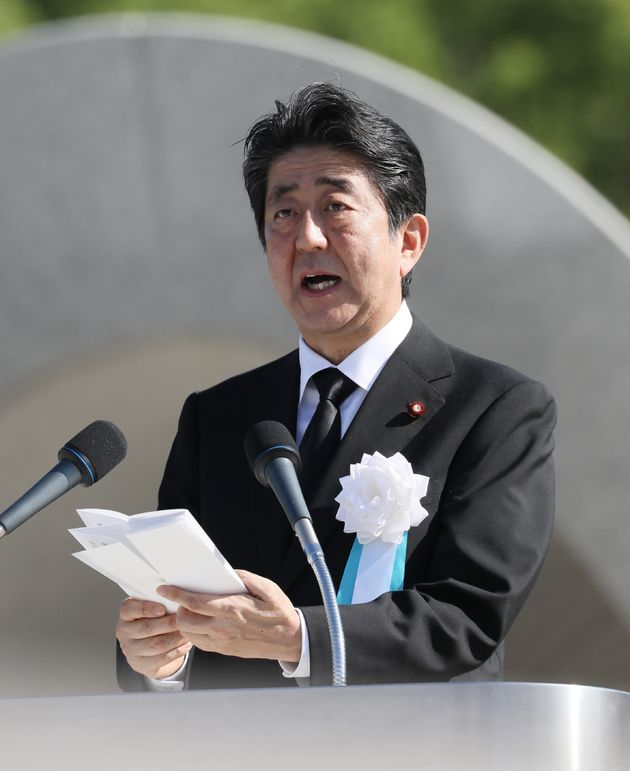 Japanese Prime Minister Shinzo Abe delivers a speech on Aug. 6, 2017, commemorating the victims of the...