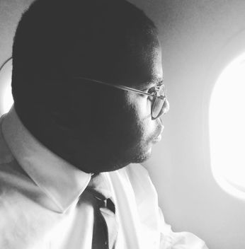 Rev. Williams while flying over Detroit, observing the lingering effects of the Detroit Rebellion of 1967.