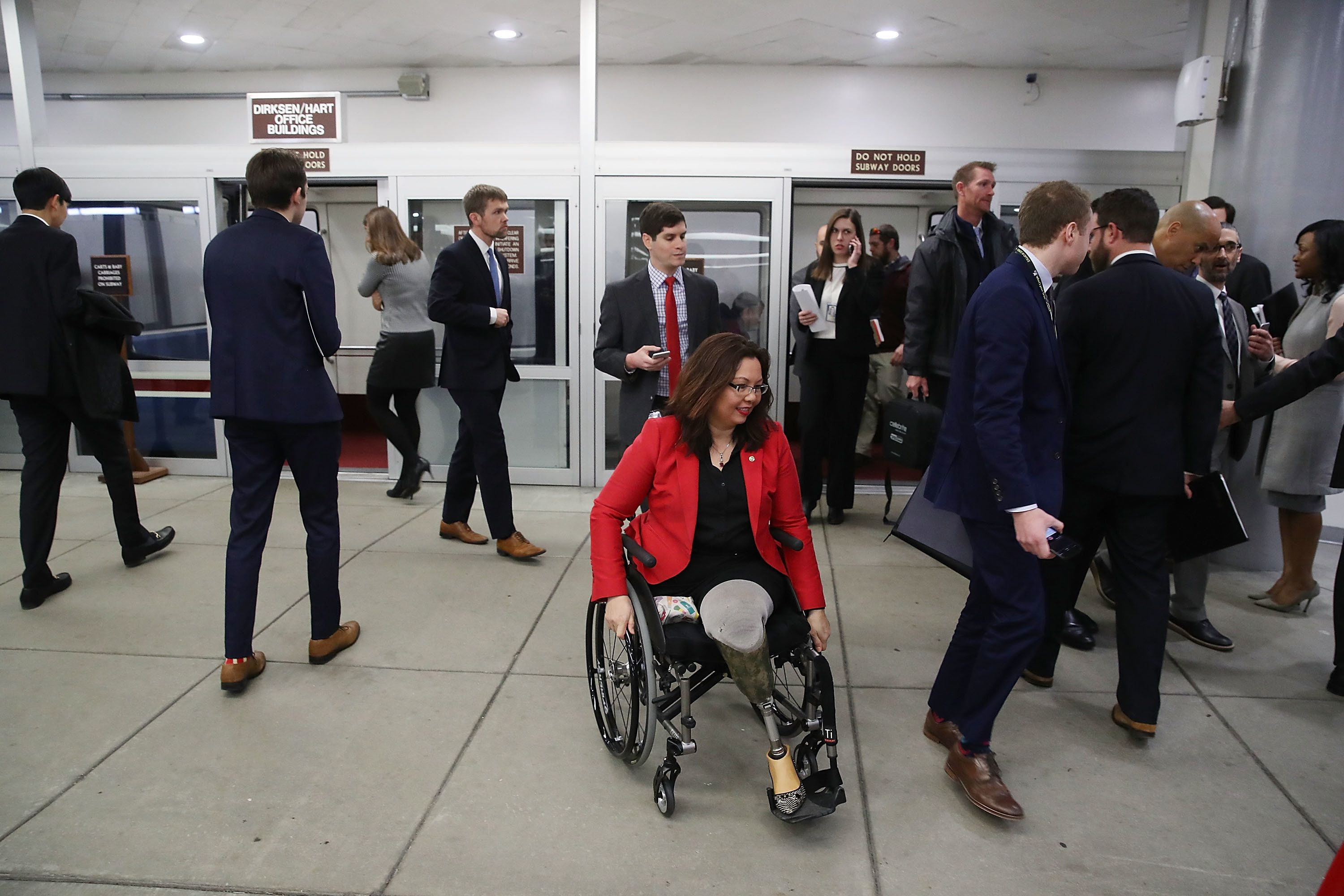 WASHINGTON, DC - JANUARY 31:  Sen. Tammy Duckworth (D-IL) travels to the Senate Chamber for a vote on Capitol Hill, January 31, 2017 in Washington, DC.  The Senate voted 93-6 to confirm Elaine Chao to head the Transportation Department.  (Photo by Mark Wilson/Getty Images)