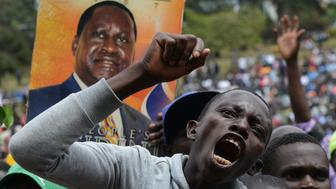 A supporter of Kenya's opposition Coalition for Reforms and Democracy (CORD) demonstrates on July 7, 2014 during their 'Saba Saba Day' rally at the Uhuru park grounds in  Nairobi. Opposition leader and former prime minister Raila Odinga has organised the rally to address what he says are major government failures, including worsening crime and insecurity, rising living costs, impunity, corruption and allegations of ethnic favouritism in government appointments. AFP PHOTO/ SIMON MAINA        (Photo credit should read SIMON MAINA/AFP/Getty Images)