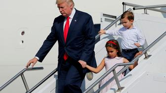 U.S. President Donald Trump, with his grandchildren Arabella Kushner and Joseph Kushner, arrives aboard Air Force One for a summer vacation at his Bedminster estate, at Morristown Airport in Morristown, New Jersey, U.S. August 4, 2017. REUTERS/Jonathan Ernst     TPX IMAGES OF THE DAY