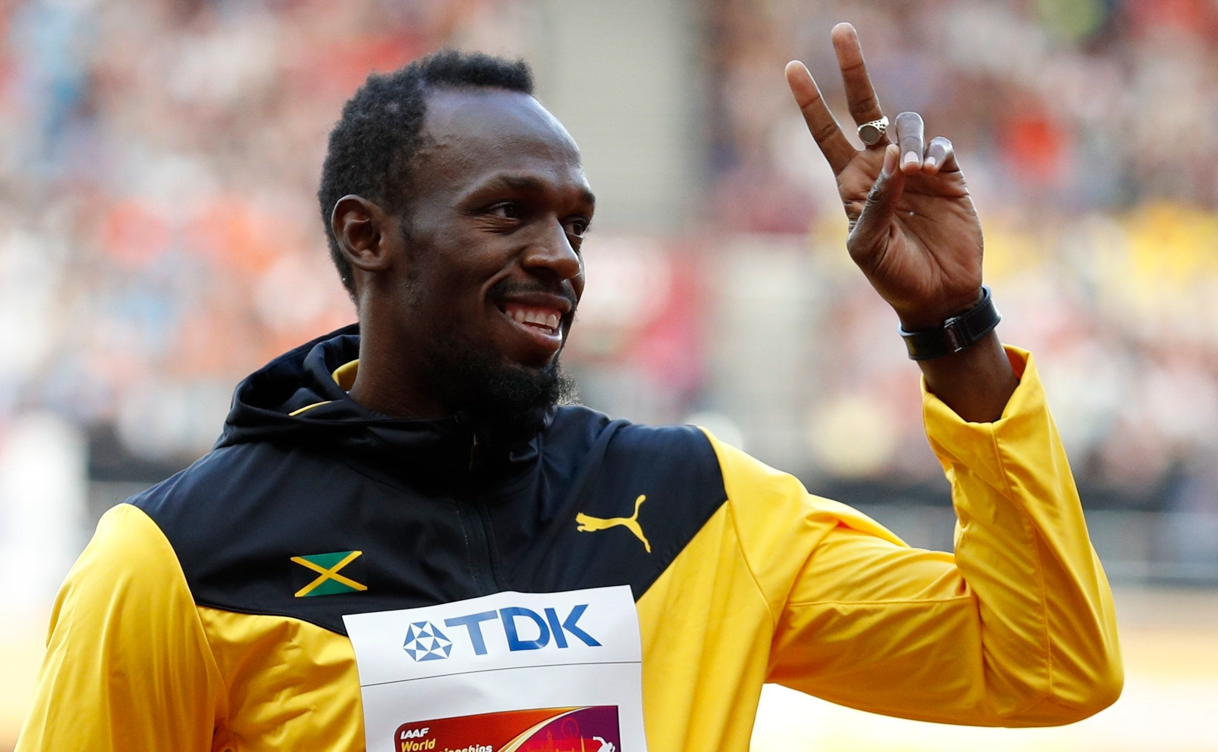 Athletics - World Athletics Championships – men's 100 metres victory ceremony – London Stadium, London, Britain – August 6, 2017 – Usain Bolt of Jamaica (Bronze) gestures on the podium. REUTERS/Phil Noble