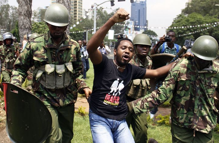 Kenyan activist Boniface Mwangi is arrested during a protest in Nairobi in 2014.