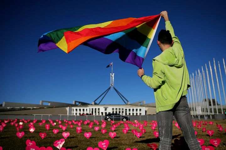 An activist supporting same sex marriage takes part in a protest in front of Australia's Parliament on Tuesday.