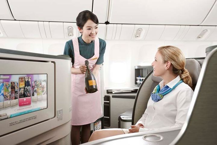 <p>EVA Air flight attendants pour fine wines to accompany meals made with fresh, seasonal ingredients on all flights and adds niceties to emphasize local luxuries on selected routes.</p>