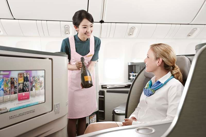 EVA Air flight attendants pour fine wines to accompany meals made with fresh, seasonal ingredients on all flights and adds ni