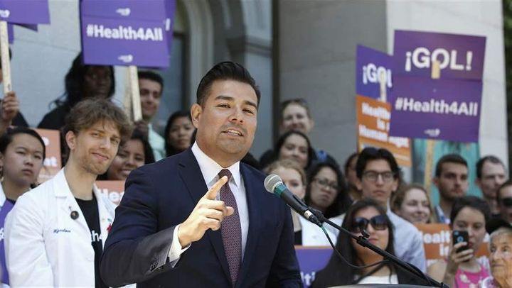 California state Sen. Ricardo Lara, a Democrat, speaks at a rally in Sacramento last year celebrating the expansion of Medica