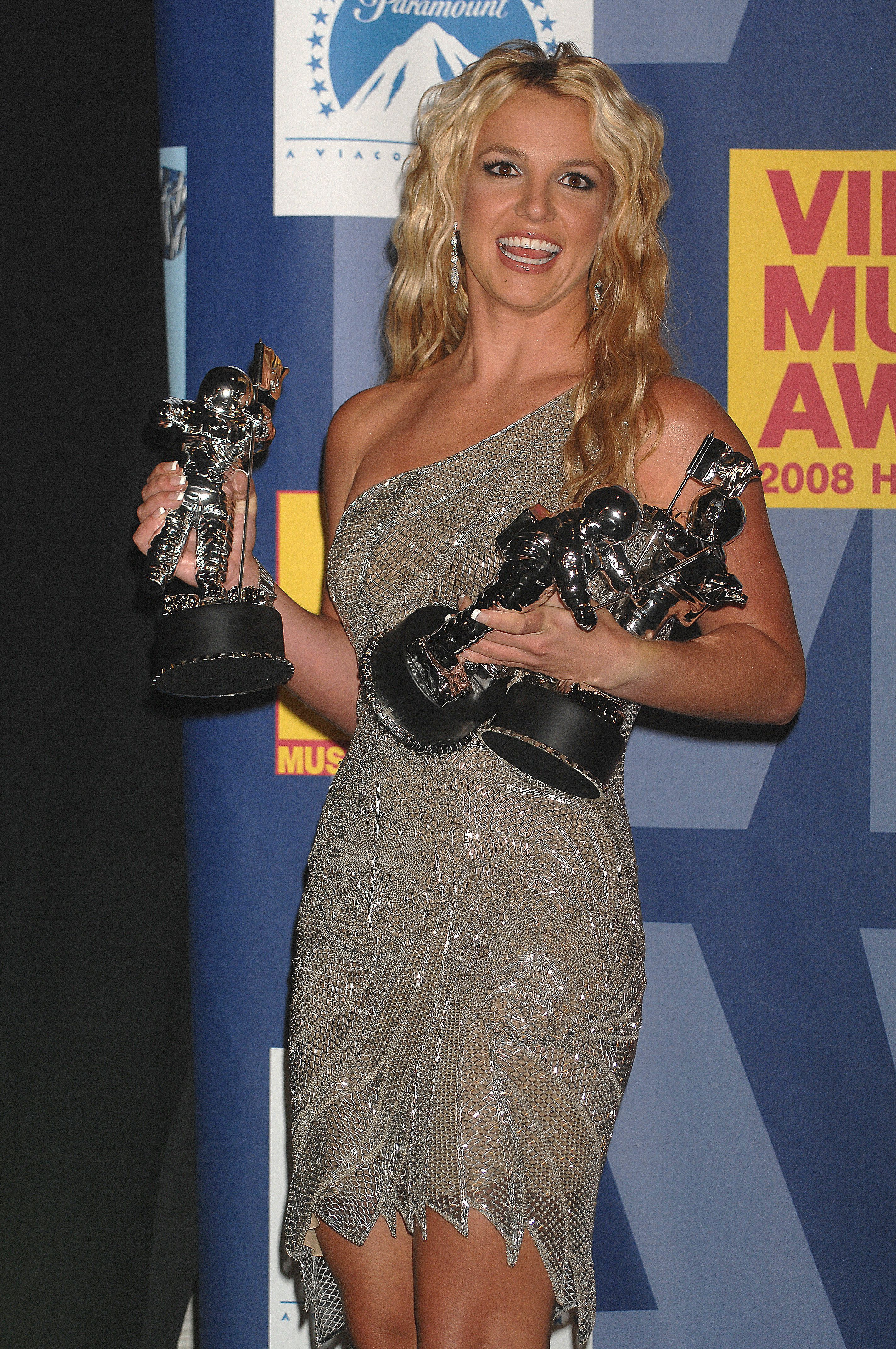 Singer Britney Spears poses with her Moonman trophies for Video of the Year, Best Female Video and Best Pop Video, at the 2008 MTV Video Music Awards held at Paramount Studios in Hollywood. (Photo by Frank Trapper/Corbis via Getty Images)