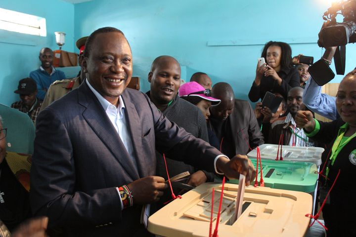 President of Kenya Uhuru Kenyatta casts his vote during the general elections, at the Mutomo Primary School polling station.
