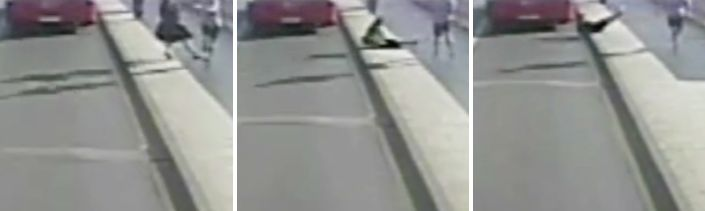 A woman is seen being knocked into the path of an oncoming bus along Putney Bridge in west London on the morning of Frid