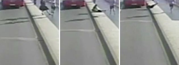 A woman is seen being knocked into the path of an oncoming bus along Putney Bridge inwest London...