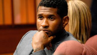 ATLANTA, GA - AUGUST 16:  Usher Raymond attends a hearing to discuss child custody with his ex-wife Tameka Foster at Fulton County State Court on August 16, 2012 in Atlanta, Georgia. Usher and Tameka, who officially divorced in 2009, are fighting over custody of their two young sons. The judge heard closing arguments today.  (Photo by John E. Davidson/Getty Images)