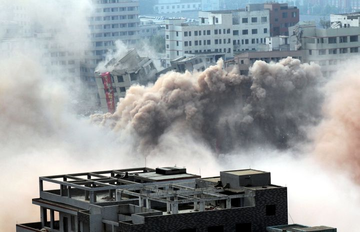 Watch Lots Of Buildings Collapse In Seconds During Controlled Blast