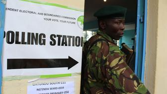 NAIROBI, KENYA - AUGUST 08 : A security member takes security measures during the general elections, at the Mutomo Primary School polling station in Gatundu Neighborhood of Nairobi, Kenya on August 08, 2017. Kenyans vote for selecting President, MPs, senators, governors and districts' heads. (Photo by Andrew Wasike/Anadolu Agency/Getty Images)